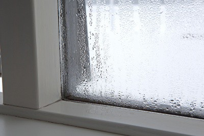 How does double glazing reduce condensation