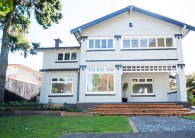 Hamilton stucco home with timber joinery - retro double glazed