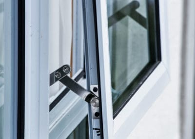 Close-up of aluminium awning and fixed windows - retrofitted with double glazing