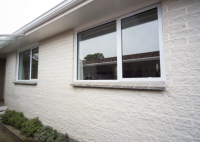 Replacement windows into 1970s brick clad home