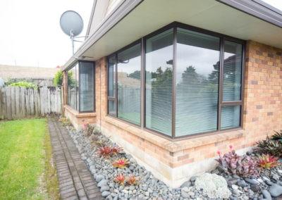 aluminium retrofit double glazing showing corner window