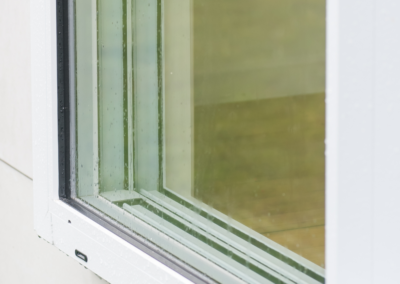 Replacement stacking sliding door, close-up detail of bottom corner
